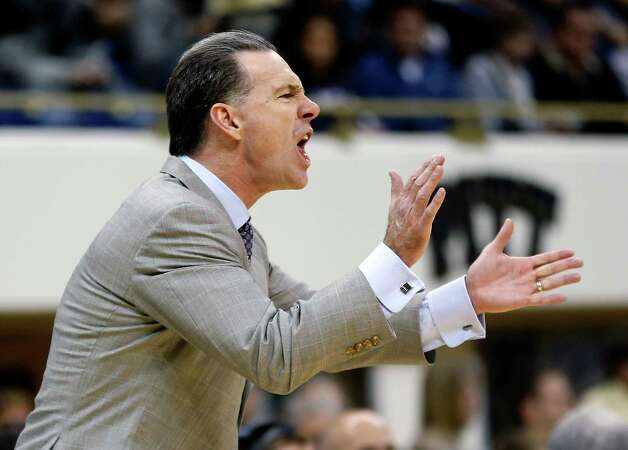 Pittsburgh head coach Jamie Dixon urges his team on as they play in the second half of an NCAA college basketball game against Connecticut, Saturday, Jan. 19, 2013, in Pittsburgh. Pittsburgh won 69-61. (AP Photo/Keith Srakocic) Photo: Keith Srakocic, Associated Press / AP