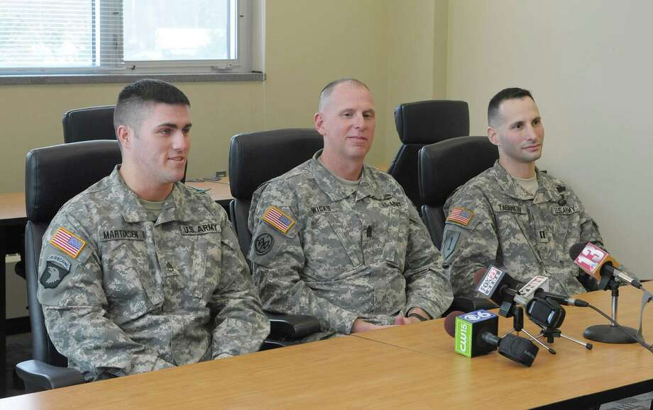 Members of the New York Army National Guard, from left to right, Staff Sgt. David Martinsen, of Troy, New York State Command Sgt. Major Frank Wicks, of West Sand Lake and Captain Shawn Tabankin, of Rexford, talk to members of the media during an interview at the New York Army National Guard headquarters on Thursday, Jan. 17, 2013 in Latham, NY.  The three men will be attending with a guest the Commander-in-Chief's Inaugural Ball on Monday, January 21st in Washington.  All three service members are veterans of the wars in Iraq and Afghanistan.  Tabankin has been awarded the Purple Heart and Martinsen was the New York Army National Guard full-time Non-Commissioned Officer of the Year for 2012. (Paul Buckowski / Times Union) Photo: Paul Buckowski