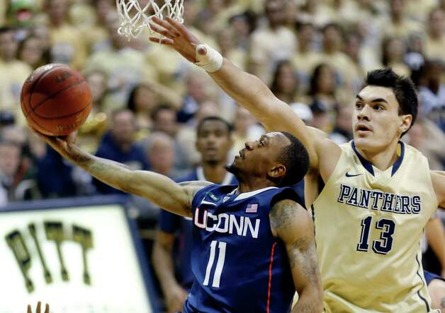 Connecticut's Ryan Boatright (11) shoots as he gets behind Pittsburgh's Steven Adams (13) during the second half of an NCAA college basketball game, Saturday, Jan. 19, 2013, in Pittsburgh. Pittsburgh won 69-61. (AP Photo/Keith Srakocic) Photo: Keith Srakocic, Associated Press / AP