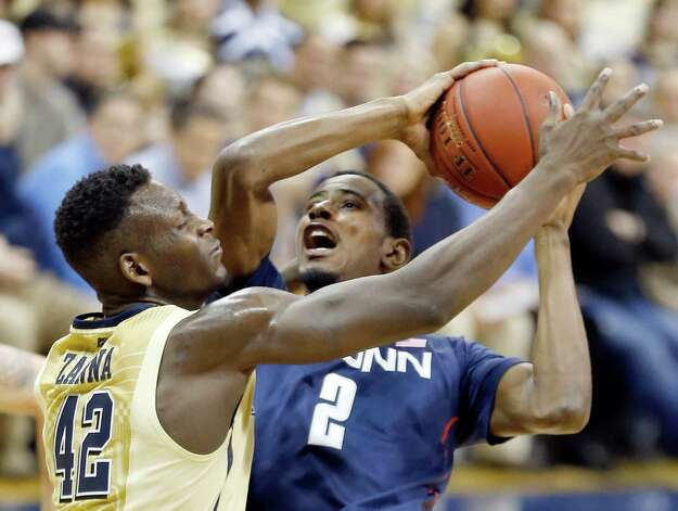 Connecticut's DeAndre Daniels (2) goes to the hoop as Pittsburgh's Talib Zanna (42) defends during the second half of an NCAA college basketball game, Saturday, Jan. 19, 2013, in Pittsburgh. Pittsburgh won 69-61. (AP Photo/Keith Srakocic) Photo: Keith Srakocic, Associated Press / AP