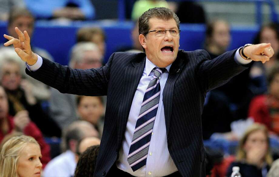 Connecticut coach Geno Auriemma calls to his team during the first half of an NCAA college basketball game against Syracuse in Hartford, Conn., Saturday, Jan. 19, 2013. (AP Photo/Fred Beckham) Photo: Fred Beckham, Associated Press / FR153656 AP