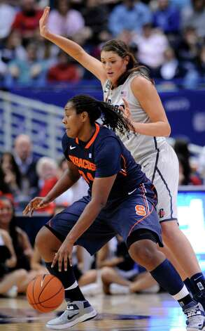 Syracuse's Shakeya Leary, left is guarded by Connecticut's Stefanie Dolson during the first half of an NCAA college basketball game in Hartford, Conn., Saturday, Jan. 19, 2013. (AP Photo/Fred Beckham) Photo: Fred Beckham, Associated Press / FR153656 AP
