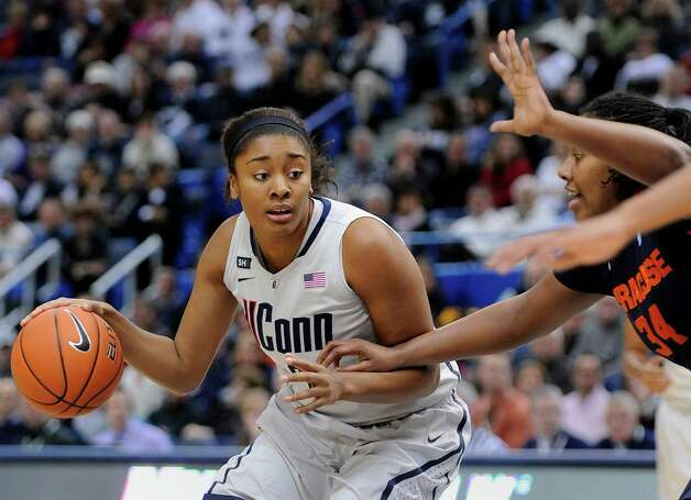 Connecticut's Morgan Tuck, left, drives past Syracuse's Shakeya Leary during the first half of an NCAA college basketball game in Hartford, Conn., Saturday, Jan. 19, 2013. (AP Photo/Fred Beckham) Photo: Fred Beckham, Associated Press / FR153656 AP