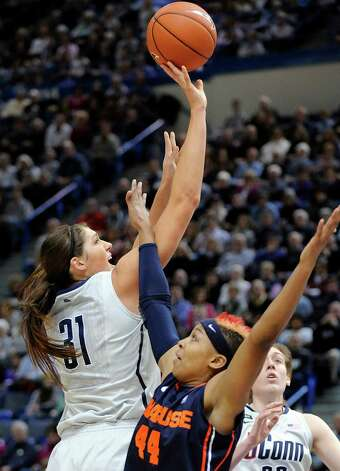 Connecticut's Stephanie Dolson, left, drives past Syracuse's Carmen Tyson-Thomas during the first half of an NCAA college basketball game in Hartford, Conn., Saturday, Jan. 19, 2013. (AP Photo/Fred Beckham) Photo: Fred Beckham, Associated Press / FR153656 AP