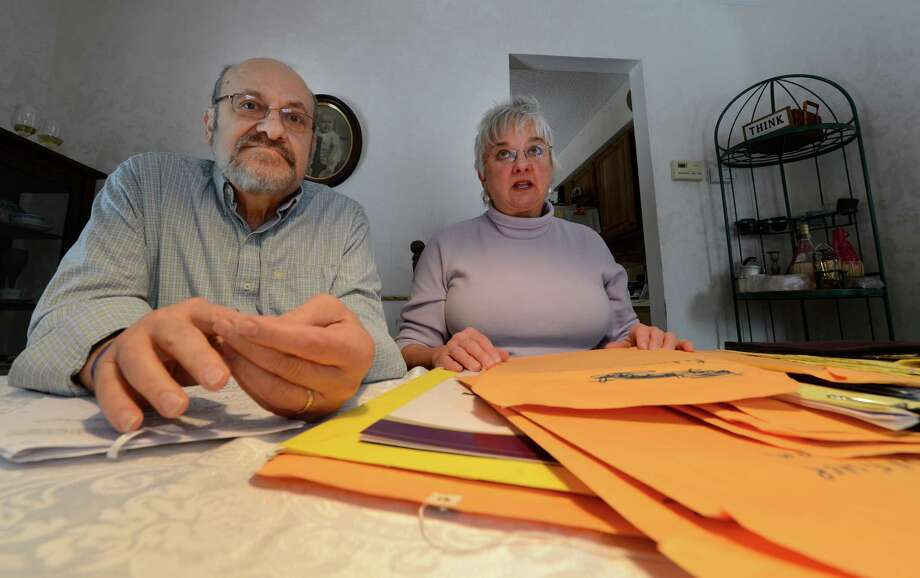 Dale Christopher, left, and his wife Karen speak to the Times Union Advocate about his health care payment problems at his home Thursday morning, Jan. 17, 2013, in Wilton, N.Y. (Skip Dickstein/Times Union) Photo: SKIP DICKSTEIN / 00020813A