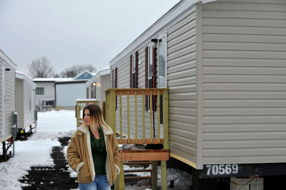 Hurricane Sandy evacuee Kelly Ackermann, of Staten Island, N.Y., stands outside the mobile home that was provided to her family by Faith Church in New Milford. Photographed on Wednesday, Jan. 16, 2013. Kelly and her husband, Scott, moved in last Friday. This is the Ackermann's fourth move since the hurricane hit. They both are currently looking for work locally so they can stay. Photo: Jason Rearick / The News-Times
