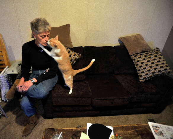 Staten Island evacuee Maryann Daino kisses her cat, Miki, inside a mobile home trailer that was provided by Faith Church in New Milford. Photographed on Wednesday, Jan. 16, 2013. Photo: Jason Rearick / The News-Times