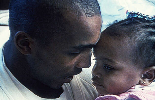 "William Gates and his daughter in ""Hoop Dreams,"" directed by Steve James. William Gates was the subject of the award-winning 1994 documentary �Hoop Dreams.� He now lives in San Antonio, where his son is a member of the Clemens High School Basketball team. Photo: Courtesy/A Fine Lines Features, Express-News"