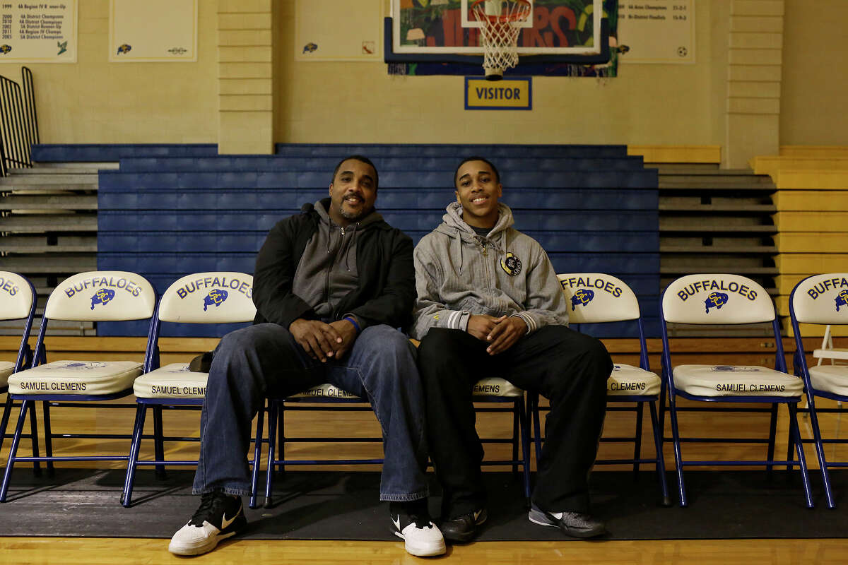 """William Gates Sr., who was the one of two high school basketball players featured in the documentary """"Hoop Dreams,"""" sits with his son, William Gates, after the younger Gates' basketball game at Samuel Clemens High School against Kerrville Tivy in Schertz on Tuesday, Jan. 15, 2013."""
