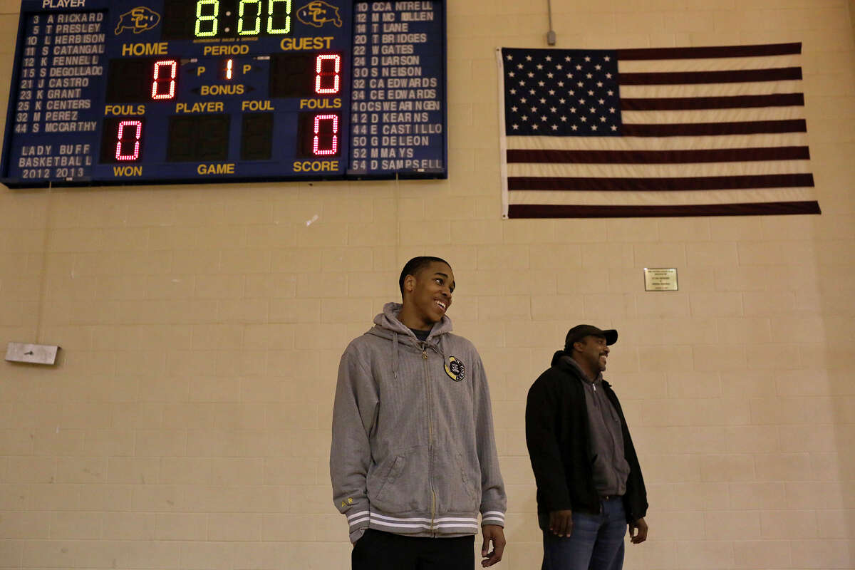 William Gates stands with his father, William Gates Sr., who was the one of two high school basketball players featured in the documentary