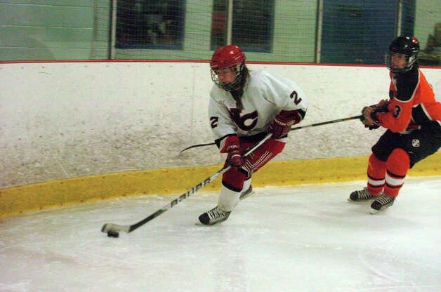 New Canaan's Catherine Granito moves along the boards as New Canaan hosts Ridgefield High School in a girls hockey game at the Darien Ice Rink in Darien, Conn., Jan. 19, 2013. Photo: Keelin Daly / Stamford Advocate Riverbend Stamford, CT