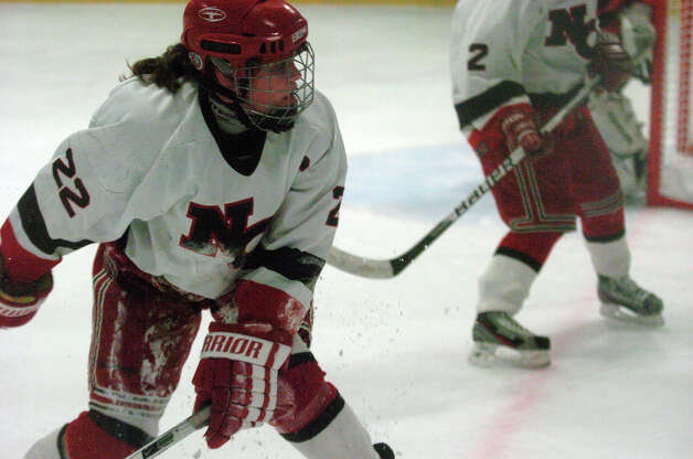New Canaan's Olivia Hompe in action as New Canaan hosts Ridgefield High School in a girls hockey game at the Darien Ice Rink in Darien, Conn., Jan. 19, 2013. Photo: Keelin Daly / Stamford Advocate Riverbend Stamford, CT