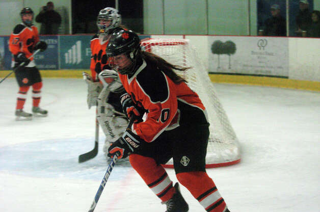 Ridgefield's Meghan Galloway in action as New Canaan hosts Ridgefield High School in a girls hockey game at the Darien Ice Rink in Darien, Conn., Jan. 19, 2013. Photo: Keelin Daly / Stamford Advocate Riverbend Stamford, CT