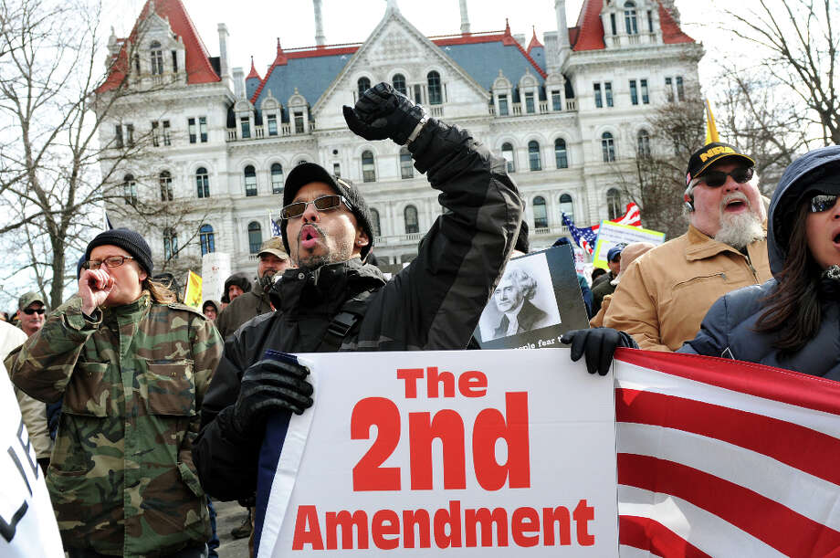 Jose Pichardo of Long Island, center, shows his support during a pro-Second Amendment and pro-gun national rally on Saturday, Jan. 19, 2013, at the Capitol in Albany, N.Y. (Cindy Schultz / Times Union) Photo: Cindy Schultz, Albany Times Union / 00020818A