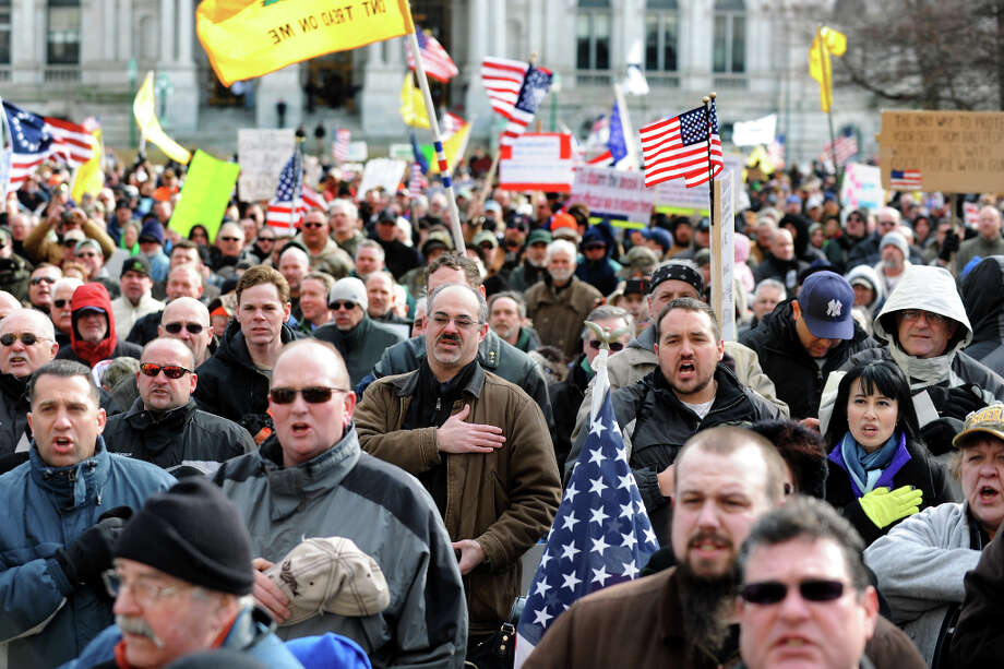 Pro-Second Amendment and pro-gun supporters recite the Pledge of Allegiance during a national rally on Saturday, Jan. 19, 2013, at the Capitol in Albany, N.Y. (Cindy Schultz / Times Union) Photo: Cindy Schultz, Albany Times Union / 00020818A