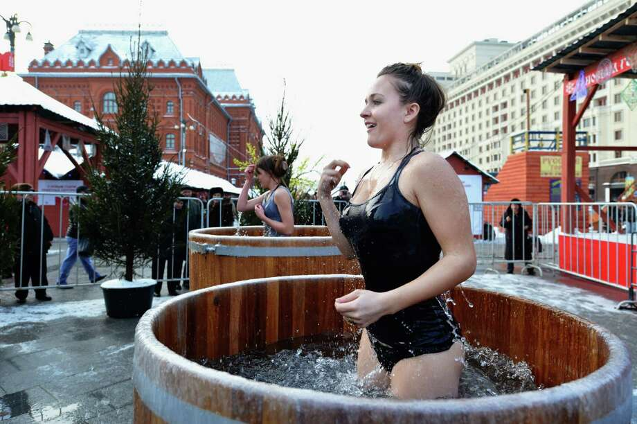Russian Orthodox church faithful mark the Epiphany by plunging into ice cold water near the Red Square in Moscow on January 19, 2012. Photo: NATALIA KOLESNIKOVA, AFP/Getty Images / AFP