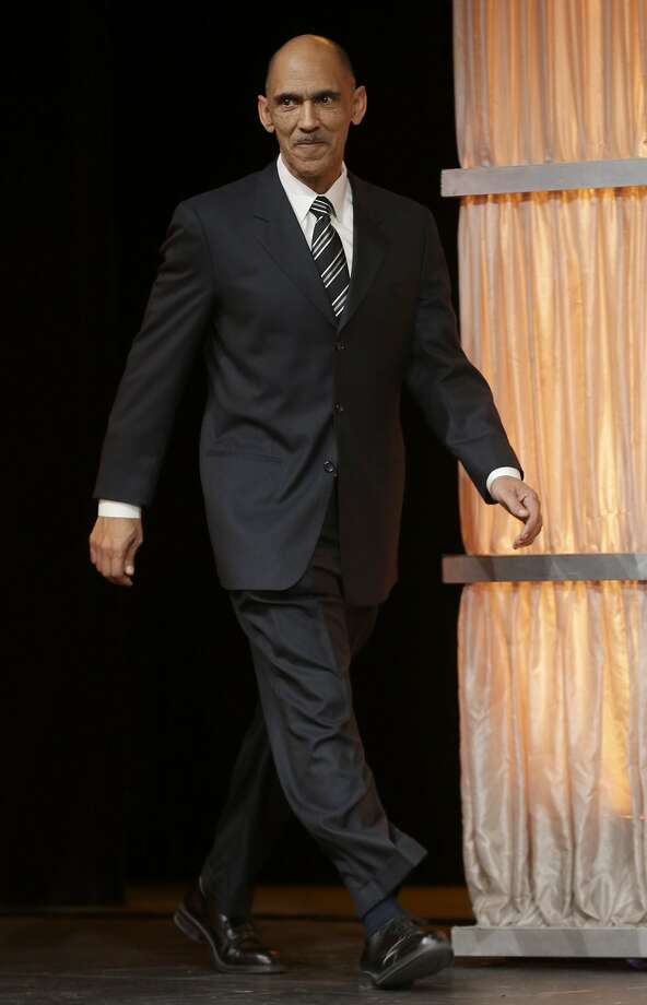 Former NFL coach Tony Dungy walks on state to accept the NCAA Roosevelt Award during the NCAA convention Friday, Jan. 18, 2013, in Grapevine, Texas. (AP Photo/LM Otero) Photo: LM Otero, Associated Press