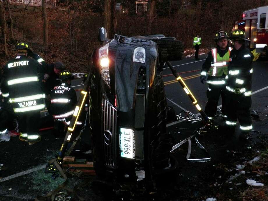 Firefighters at the scene of a single-car rollover crash Saturday afternoon at Imperial and Baker avenues.  WESTPORT NEWS, CT 01/19/13 Photo: Westport Fire Department / Westport News contributed