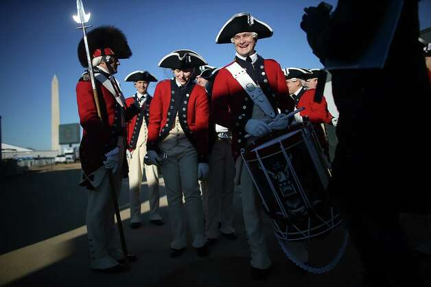 Members of the U.S. Army Old Guard Fife and Drum Corps gather after performing on the National Mall as Washington prepares for President Barack Obama's second inauguration on January 19, 2013 in Washington, DC. The U.S. capital is preparing for the second inauguration of U.S. President Barack Obama, which will take place on January 21. Photo: Mario Tama, Getty Images / 2013 Getty Images