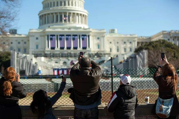 Visitors take photos of the U.S. Capitol building prepared for inauguration events January 19, 2013 in Washington DC.  The U.S. capital is preparing for the second inauguration of U.S. President Barack Obama, which will take place on January 21. Photo: Allison Shelley, Getty Images / 2013 Getty Images