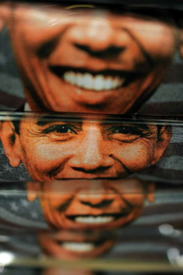 "T-shirts featuring an image of US President Barack Obama are displayed at a gift shop in Washington, DC, on January 18, 2013. Crowds may be smaller on January 21 inauguration than when Barack Obama was first sworn into office in 2009, but security is as tight as ever, with experts warning a ""lone wolf"" would pose the greatest threat. Between 500,000 and 800,000 people are expected to pass through the National Mall, the immense greenway that leads up to the Capitol, compared to the 1.8 million spectators who came to applaud Obama four years ago. Photo: JEWEL SAMAD, AFP/Getty Images / AFP"