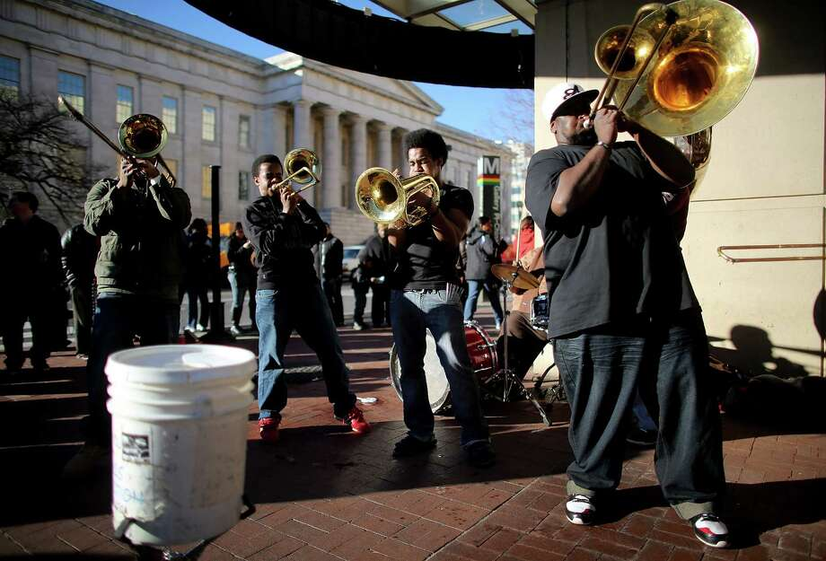 A brass band performs on a street corner as Washington prepares for President Barack Obama's second inauguration on January 19, 2013 in Washington, DC. The U.S. capital is preparing for the second inauguration of U.S. President Barack Obama, which will take place on January 21. Photo: Mario Tama, Getty Images / 2013 Getty Images