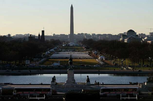 Tour buses and tourists are seen near the U.S. Capitol on January 18, 2013 in Washington, DC.  The U.S. capital is preparing for the second inauguration of U.S. President Barack Obama, which will take place on January 21. Photo: Justin Sullivan, Getty Images / 2013 Getty Images