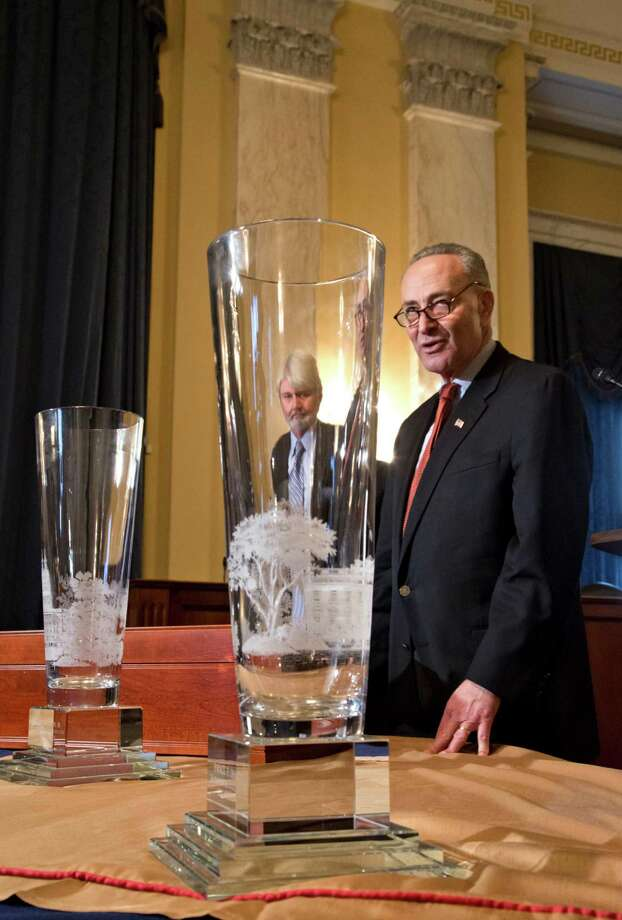 Sen. Charles Schumer, D-N.Y., chairman of the Joint Congressional Committee on Inaugural Ceremonies, right, displays the official inaugural gifts to be presented to President Barack Obama and Vice President Joe Biden, during the 57th Presidential Inaugural, Friday, Jan. 18, 2013, at a news conference on Capitol Hill in Washington. The crystal vases are custom designed and engraved by Lenox. Lenox Vice President of Design Tim Carder is at left. Photo: J. Scott Applewhite, Associated Press / AP