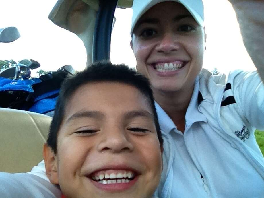 Rachel Ryan with son Aiden enjoying a round of golf   Photo provided by Rachel Ryan