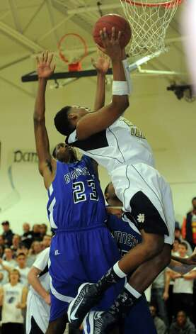 Notre Dame-Fairfield's Jaylon Jennings puts up the ball as Bunnell High School's Isaac Vann (23) defends during game action in Fairfield, Conn. Saturday, Jan. 19, 2013. Photo: Autumn Driscoll / Connecticut Post