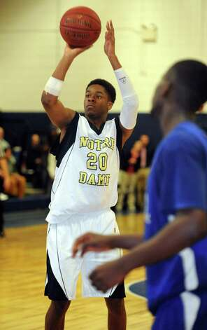 Notre Dame-Fairfield's Jaylon Jennings makes the game-winning free throw in the final seconds of boys basketball action against Bunnell High School Saturday, Jan. 19, 2013 in Fairfield, Conn. Photo: Autumn Driscoll / Connecticut Post