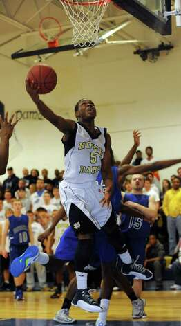 Notre Dame-Fairfield's Earl Coleman attempts a shot during game action against Bunnell High School Saturday, Jan. 19, 2013  in Fairfield, Conn. Photo: Autumn Driscoll / Connecticut Post
