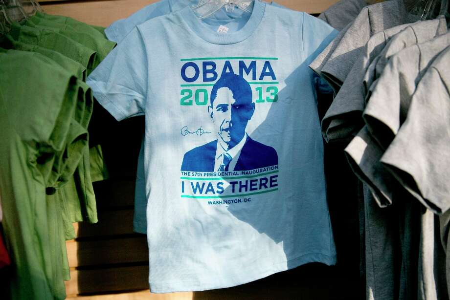 U.S. President Barack Obama t-shirts sit on display for sale at a gift shop in Washington, D.C., U.S., on Friday, Jan. 18, 2013. President Obama's second inauguration next week will combine the star power of Beyonce, Kelly Clarkson and James Taylor with a lineup that reflects social values Obama will champion in his new term. Photo: Andrew Harrer, Bloomberg / © 2013 Bloomberg Finance LP