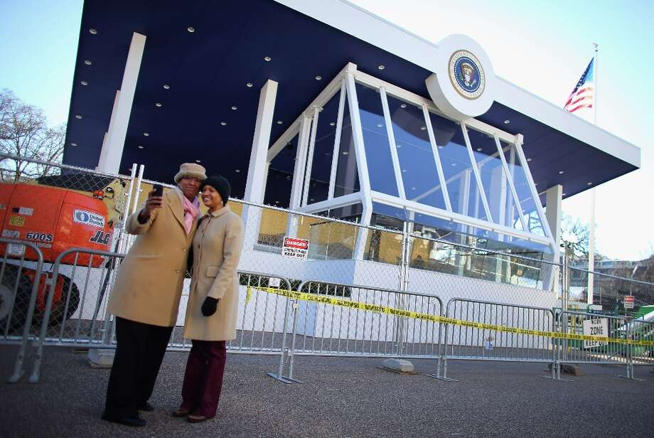 Marqita Karen (L) and Angela Pea take a picture of themselves in front of the presidential inaugural parade reviewing stand on January 18, 2013 in Washington, DC.  The U.S. capital is preparing for the second inauguration of U.S. President Barack Obama, which will take place on January 21. Photo: Joe Raedle, Getty Images / 2013 Getty Images