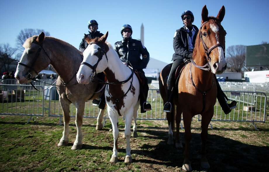 Mounted police keep watch in front of the Washington Monument on the National Mall as Washington prepares for President Barack Obama's second inauguration on January 19, 2013 in Washington, DC. The U.S. capital is preparing for the second inauguration of U.S. President Barack Obama, which will take place on January 21. Photo: Mario Tama, Getty Images / 2013 Getty Images