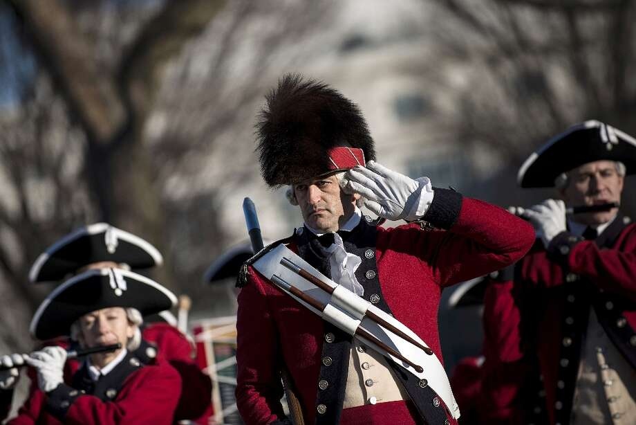 Members of the US Army's Old Guard's Fife and Drum Corps perform on the National Mall, January 19, 2013 in Washington, DC. Preparations for this Monday's ceremonial inauguration for US President Barack Obama's second term continue. Photo: BRENDAN SMIALOWSKI, AFP/Getty Images / 2012 Brendan Smialowski