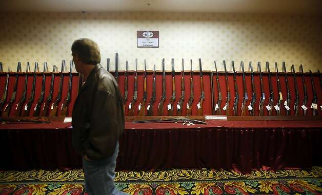 At the Antique Gun Show, about 300 exhibitors sell both aging and modern firearms. Photo: Isaac Brekken, San Francisco Chronicle
