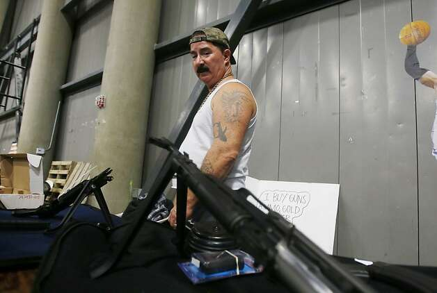 Joe, a private seller who declined to give his last name, attempts to sell an AK-47 at the Las Vegas Gun Show for $3,500. Photo: Isaac Brekken, San Francisco Chronicle