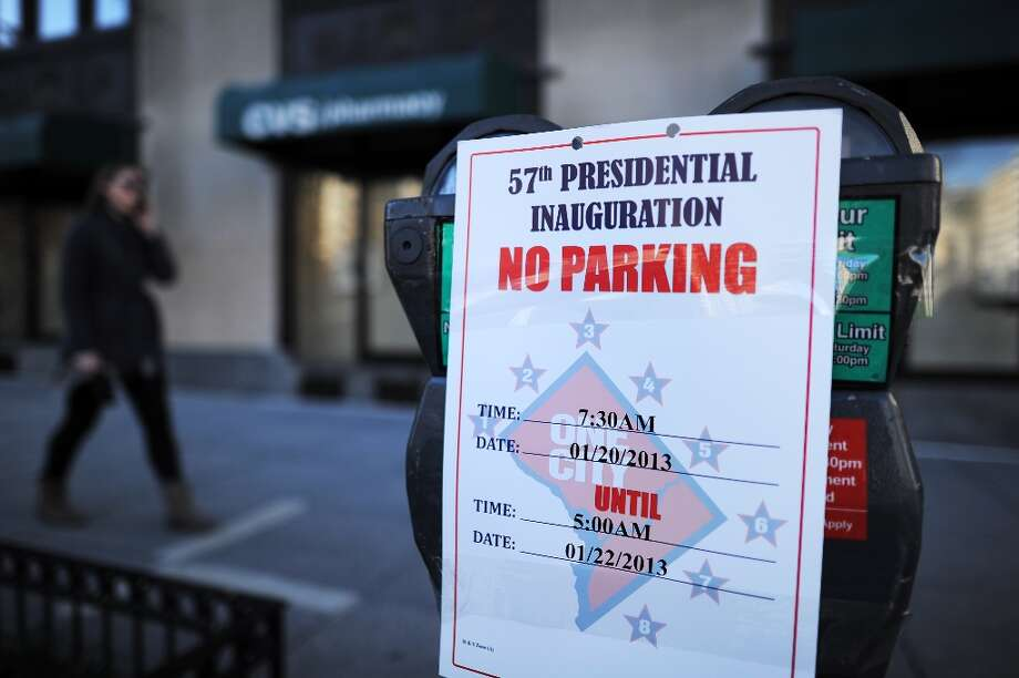Parking restrictions are posted on meters on January 19, 2013 in Washington DC, part of preparations for the second inauguration of US President Barack Obama. Paintbrushes in hand, Barack and Michelle Obama kicked off inauguration weekend Saturday at a volunteer event at a Washington school, one of hundreds of such events organized across the US. Photo: JEWEL SAMAD, AFP/Getty Images / AFP