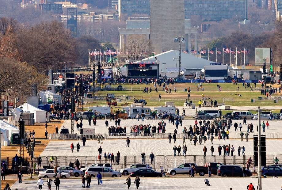 Work continues as work crews lay down special mats to protect the lawn on the National Mall, looking toward the Washington Monument and the Lincoln Memorial in Washington, Saturday, Jan. 19, 2013, for the 57th Presidential Inauguration, and President Barack Obama's second inauguration ceremonies. Photo: J. Scott Applewhite, Associated Press / AP