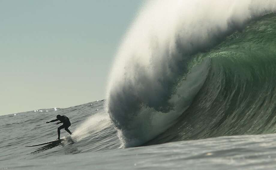 A surfer zips ahead of a wave at Mavericks as anticipation built for Sunday's big-wave contest. Photo: Mathew Sumner, Special To The Chronicle