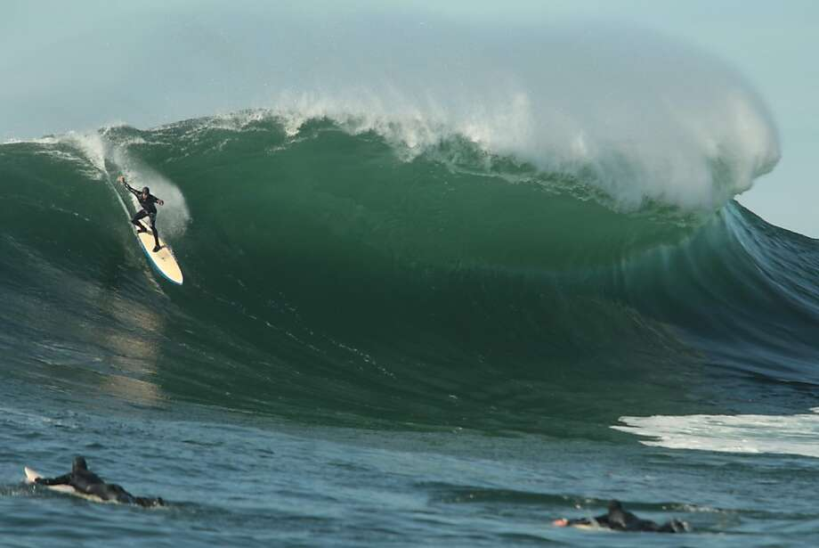 On the day before the Mavericks Invitational, a surfer rides a wave at the big wave spot on Saturday, January 19, 2013. Photo: Mathew Sumner, Special To The Chronicle