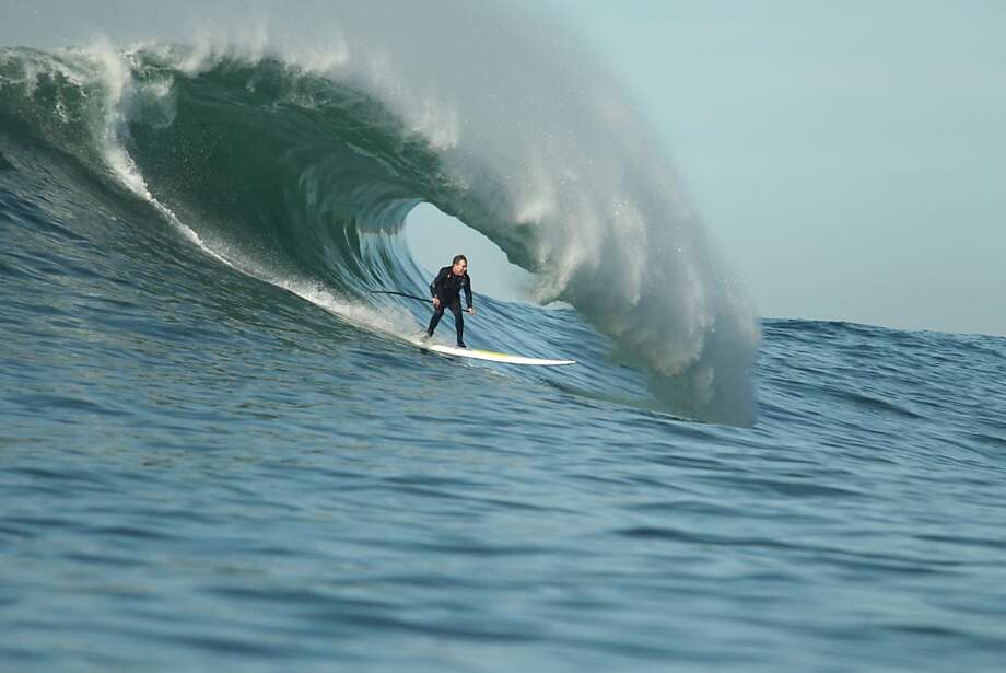 Mavericks pioneer Jeff Clark rides a wave at the legendary spot on the day before the Mavericks Invitational on Saturday, January 19, 2013. Photo: Mathew Sumner, Special To The Chronicle