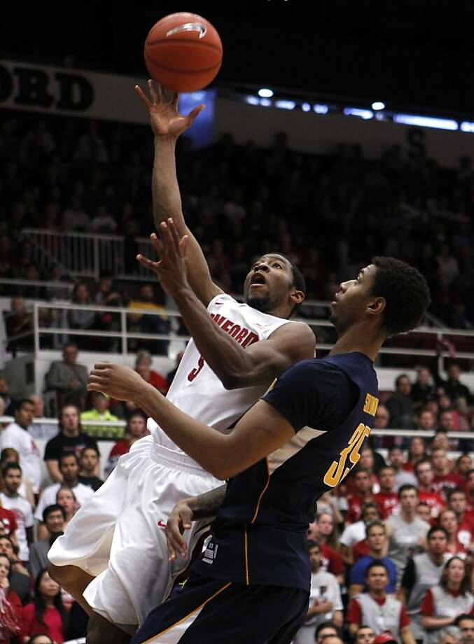 Stanford's Chasson Randle launches a second-half shot against Cal's Richard Solomon. Photo: Paul Chinn, The Chronicle