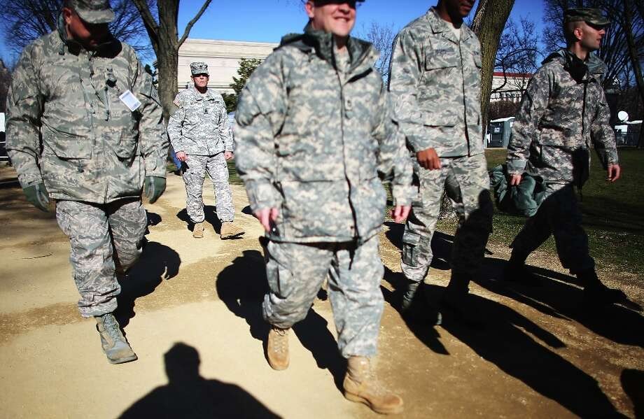 U.S. Army soldiers walk on the National Mall as Washington prepares for President Barack Obama's second inauguration on January 19, 2013 in Washington, DC. The U.S. capital is preparing for the second inauguration of U.S. President Barack Obama, which will take place on January 21. Photo: Mario Tama, Getty Images / 2013 Getty Images
