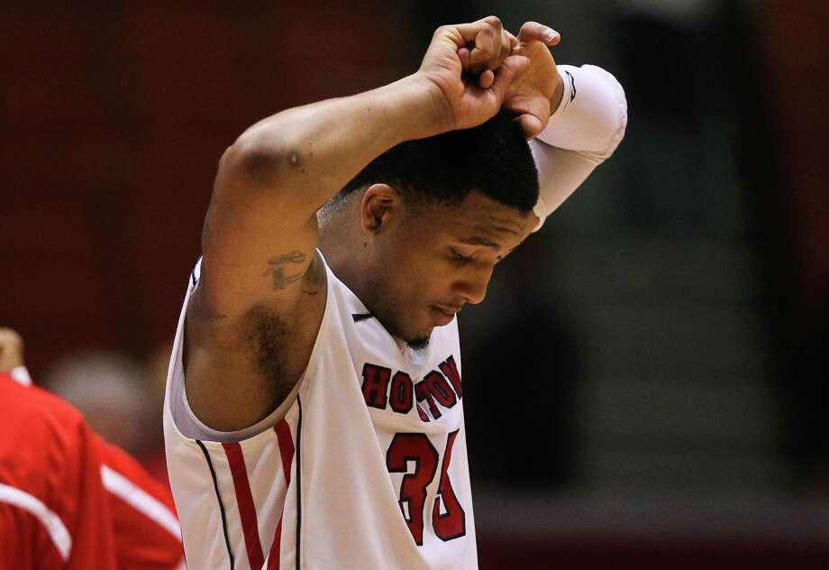 Houston forward TaShawn Thomas paces as time runs out on his overtime loss to Central Florida during a an NCAA basketball game, Saturday, Jan. 19, in Hofheinz Pavilion in Houston. Photo: Nick De La Torre, Houston Chronicle / © 2013  Houston Chronicle