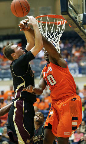 Edrico McGregor rejects a shot by Bobcat Matt Staff as UTSA hosts Texas State in mens' basketball at the UTSA Convocation Center on January 19, 2013. Photo: Tom Reel, Express-News / ©2012 San Antono Express-News