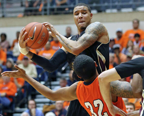 Corey Stern rips away a rebound for the Bobcats as UTSA hosts Texas State in mens' basketball at the UTSA Convocation Center on January 19, 2013. Photo: Tom Reel, Express-News / ©2012 San Antono Express-News