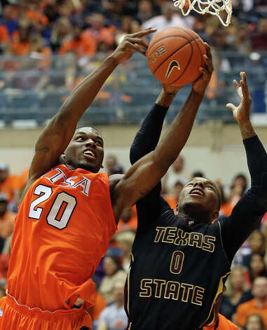 Edrico McGregor snares a rebound from the Bobcats Phil Hawkins as UTSA hosts Texas State in mens' basketball at the UTSA Convocation Center on January 19, 2013. Photo: Tom Reel, Express-News / ©2012 San Antono Express-News