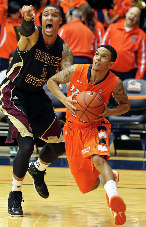 Roadrunner guard Michael Hale III breaks loose, leaving behind Corey Stern as UTSA hosts Texas State in mens' basketball at the UTSA Convocation Center on January 19, 2013. Photo: Tom Reel, Express-News / ©2012 San Antono Express-News